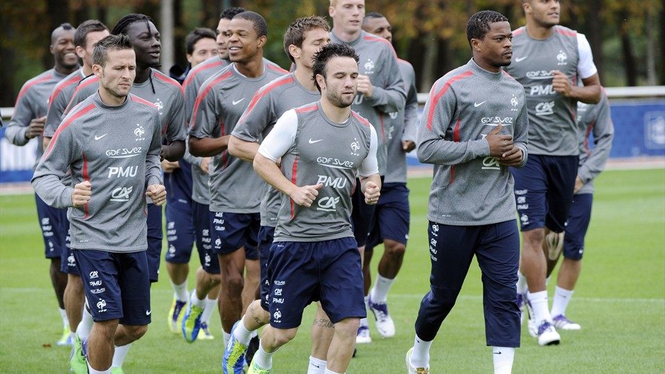 Soccer players jogging as a warmup exercise