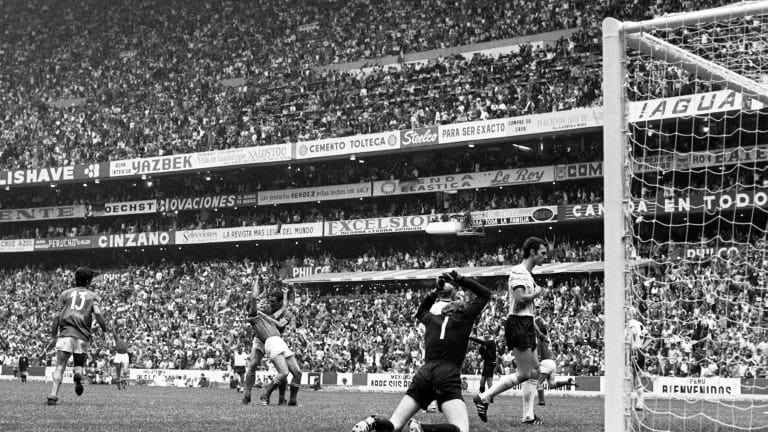 Gianni Rivera scores Italy's winning goal in the 1970 semi-final against West Germany